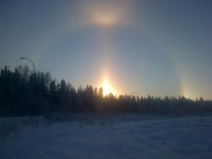 Sundog! You know its cold when there is a halo around the sun.